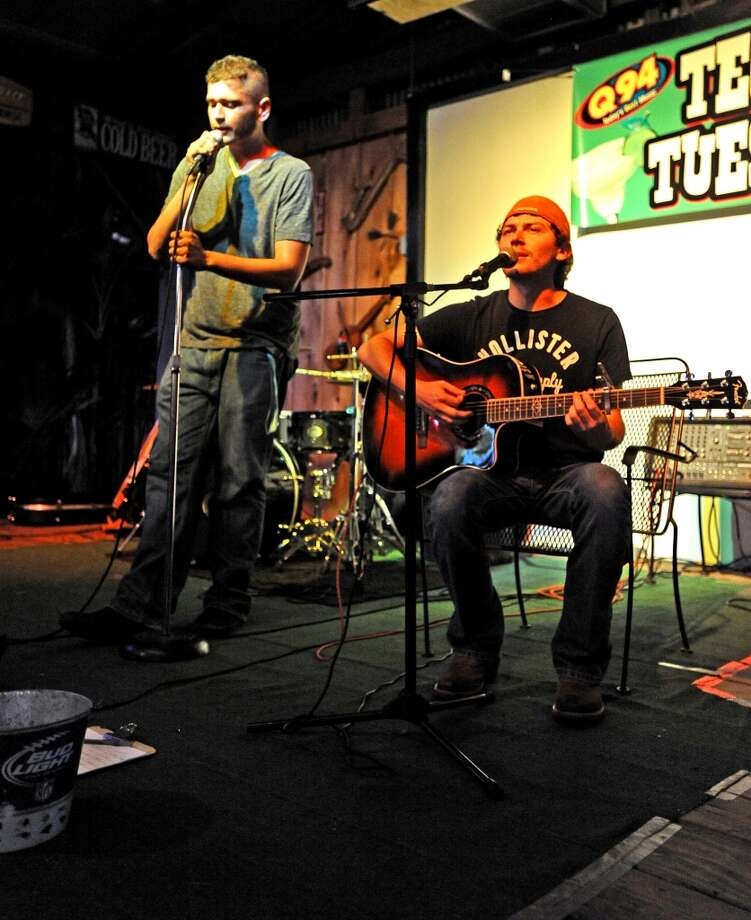 Gabe White, left, and Matt Weigand, right, take the stage during open mic at Musician's Night held every Tuesday at Starvin Marvin's in Beaumont on Tuesday, June 25, 2013. Photo taken: Randy Edwards/The Enterprise