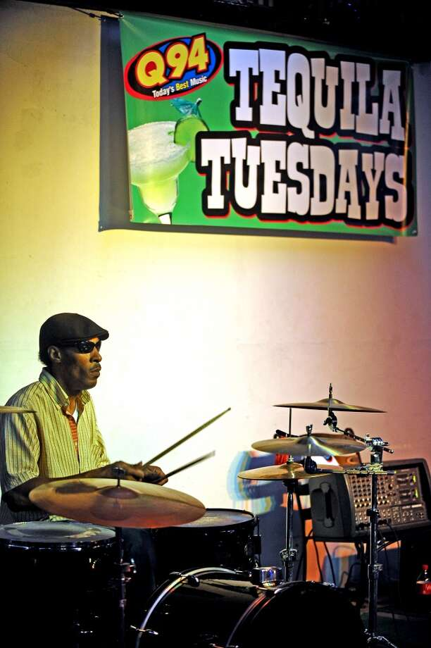 Robert Smith opens up Musician's Night playing drums in the house band at Starvin Marvin's in Beaumont on Tuesday, June 25, 2013. Photo taken: Randy Edwards/The Enterprise