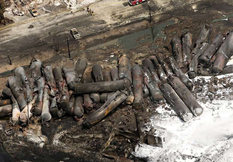 The remains of tanker cars lie burnt out in the downtown core Sunday, July 7, 2013, in Lac Megantic,