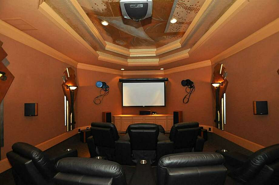 You'll also be able to enjoy this in-home theater.