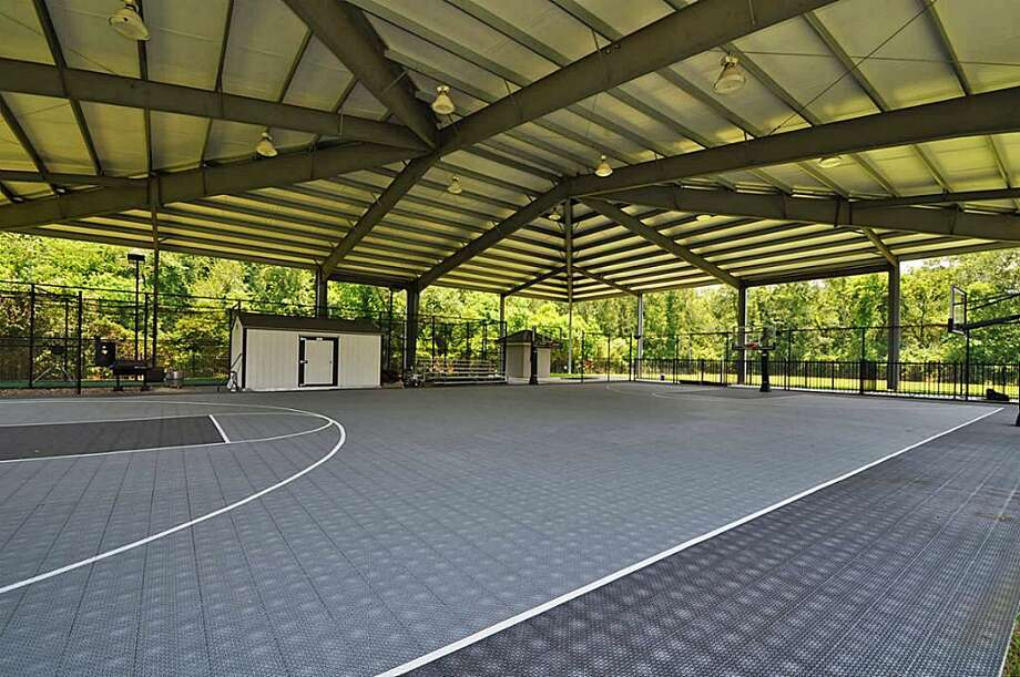 A large covered basketball court, tennis court and private batting cage. The area also has a full bathroom.