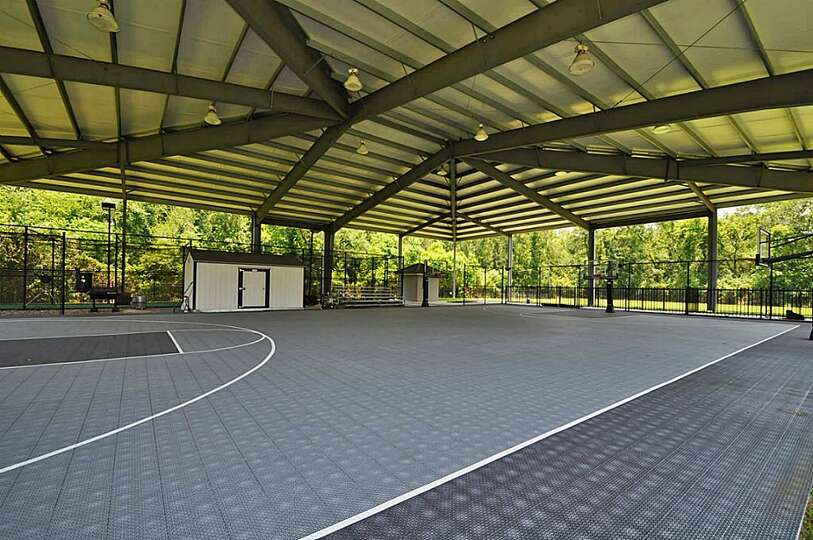 A large covered basketball court tennis court and private for Personal basketball court