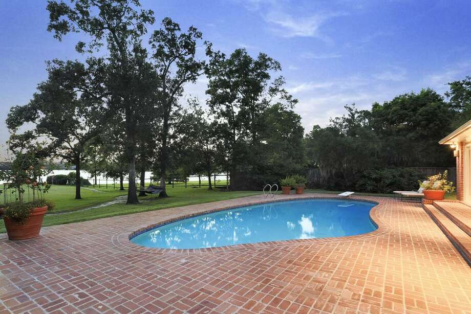 This Seabrook home features three bedrooms and four bathrooms with more than 4,000 of living space. It also within feet of Taylor Lake.