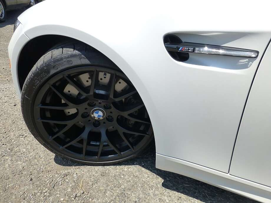 Hefty black 19-inch wheels and the M3 flash on the fender set the car apart from the normal 3-series BMWs.