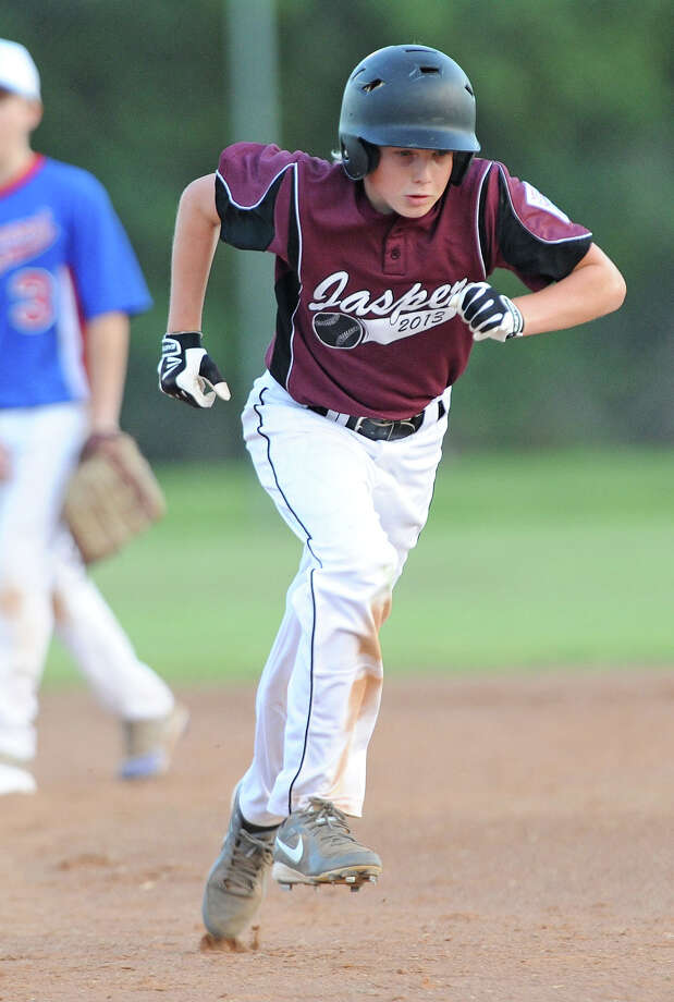 Jasper's Michael Esralante runs toward third during the District 12 12U Jr. League Championship game against The West End Little League at Amelia on Monday.  Photo taken Monday, July 01, 2013 Guiseppe Barranco/The Enterprise Photo: Guiseppe Barranco, STAFF PHOTOGRAPHER / The Beaumont Enterprise