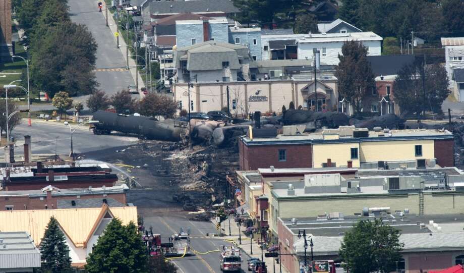 Damage in the downtown of Lac Megantic, Quebec is seen Sunday, July 7, 2013, the day after a train derailed causing explosions of railway cars carrying crude oil. (AP Photo/The Canadian Press, Paul Chiasson) Photo: Associated Press