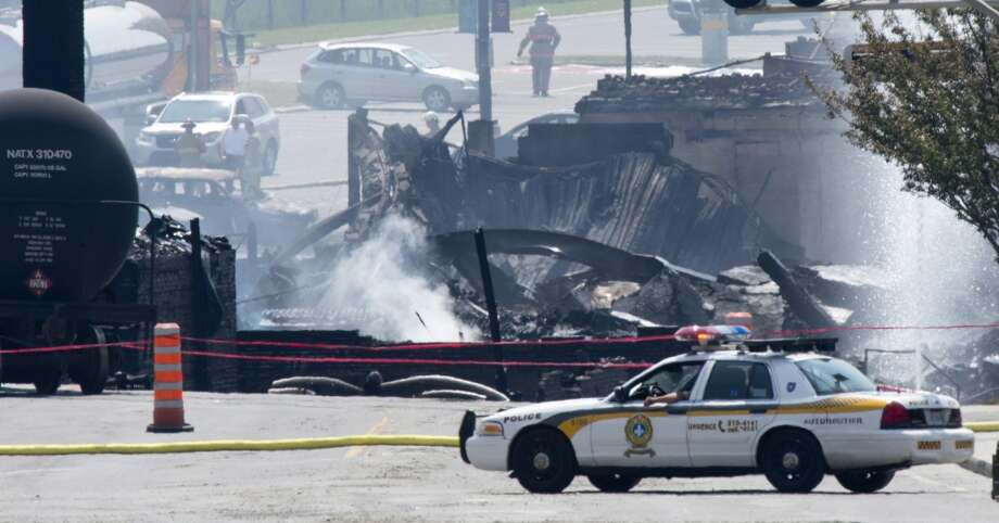 Burnt buildings are seen following a train derailment causing explosions of railway cars carrying crude oil Sunday, July 7, 2013 in Lac Megantic, Quebec. Two more bodies were discovered overnight after a runaway train carrying crude oil derailed in eastern Quebec, igniting explosions and fires that destroyed a town's downtown center. The confirmed death toll is now three, and is expected to rise further. (AP Photo/The Canadian Press, Paul Chiasson Photo: Associated Press