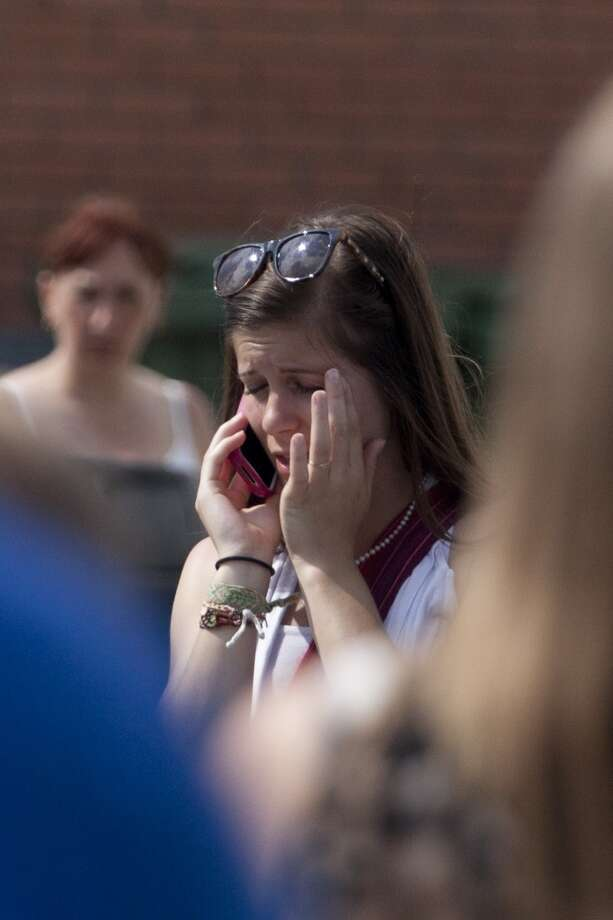 A woman speaks on a mobile phone in the emergency camp set up at Lac-Mégantic high school on July 7, 2013 in Lac-Megantic, Quebec, Canada, on July 7, 2013 in Lac-Megantic, Quebec, Canada, one day after a train derailment and subsequent explosion and fire.   Five bodies of victims have been recovered in Quebec from the catastrophic derailment of an oil-laden cargo train, but 40 people are missing and the toll is expected to rise, Canadian officials said.      AFP PHOTO /  François Laplante-DelagraveFrançois Laplante-Delagrave/AFP/Getty Images Photo: AFP/Getty Images