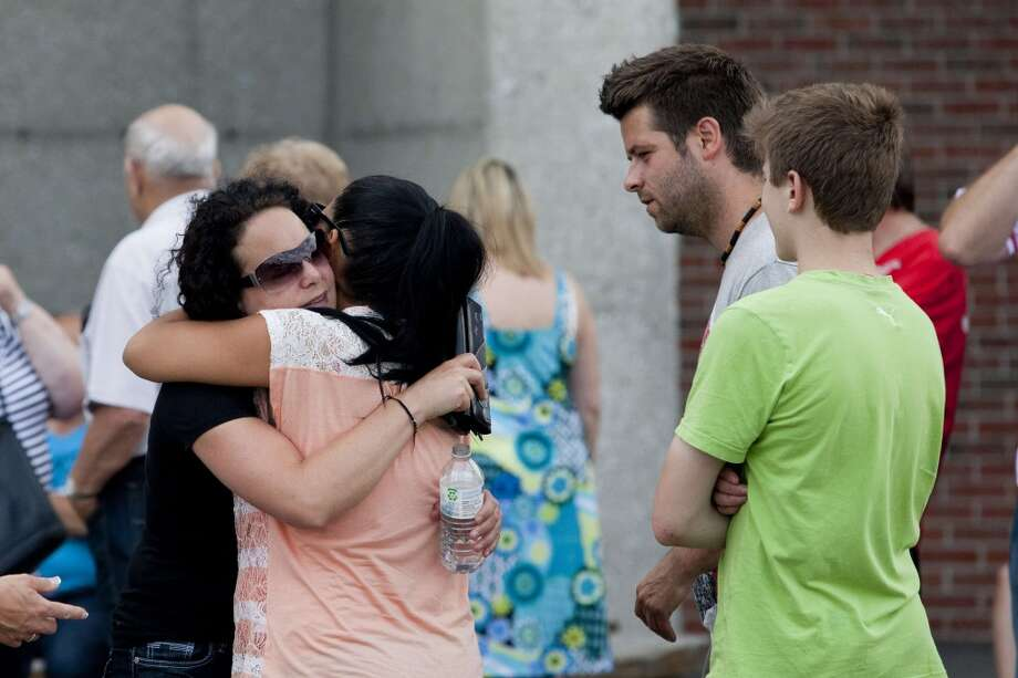 Families embrace in the emergency camp set up at Lac-Mégantic high school on July 7, 2013 in Lac-Megantic, Quebec, Canada, one day after a train derailment and subsequent explosion and fire.   Five bodies of victims have been recovered in Quebec from the catastrophic derailment of an oil-laden cargo train, but 40 people are missing and the toll is expected to rise, Canadian officials said.      AFP PHOTO /  François Laplante-DelagraveFrançois Laplante-Delagrave/AFP/Getty Images Photo: AFP/Getty Images