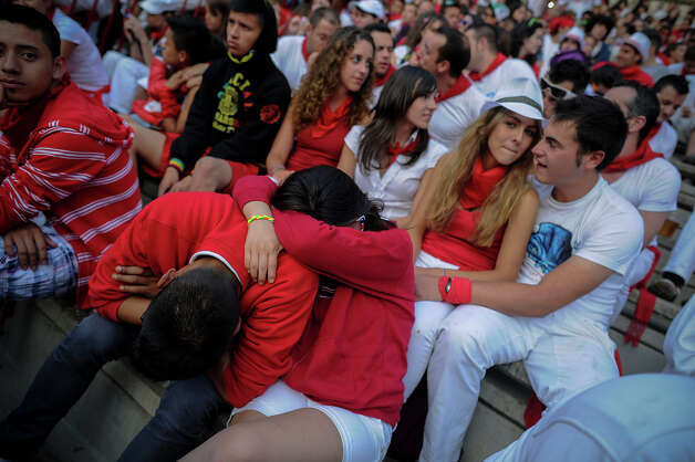 A couple sleep as they wait for the second bull run of the San Fermin Festival in Pamplona, northern Spain, on July 8, 2013. The festival is a symbol of Spanish culture that attracts thousands of tourists to watch the bull runs despite heavy condemnation from animal rights groups. Photo: PEDRO ARMESTRE, AFP/Getty Images / 2013 AFP