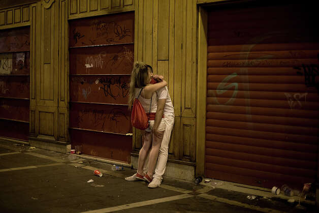 Revellers kiss on the street in the early hours ahead of Dolores Aguirre's ranch fighting bulls running on the third day of the San Fermin Running Of The Bulls festival, on July 8, 2013 in Pamplona, Spain. The annual Fiesta de San Fermin, made famous by the 1926 novel of US writer Ernest Hemmingway 'The Sun Also Rises', involves the running of the bulls through the historic heart of Pamplona for nine days from July 6-14. Photo: Pablo Blazquez Dominguez, Getty Images / 2013 Getty Images