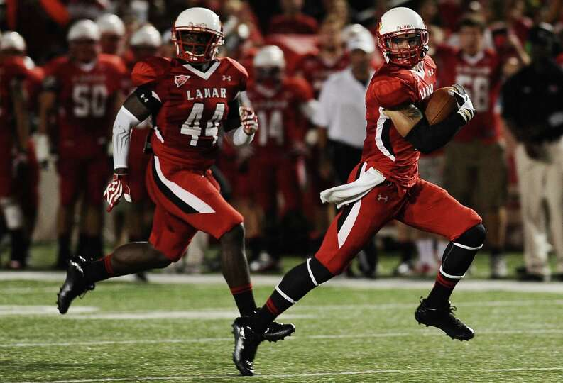 Lamar  wide receiver Kevin Johnson runs a kick off back in the first quarter for a touchdown during