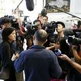 Yang Lin, a passenger of the Asiana Boeing 777 that crash landed at San Francisco International airport, talks with the media at the Chinese Consulate building in San Francisco, Calif. on July 7, 2013.