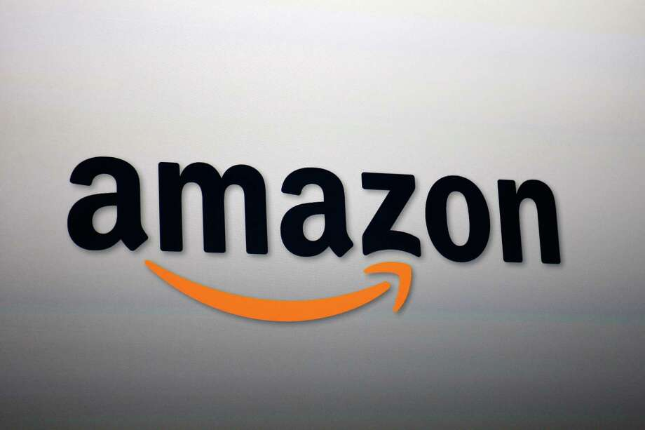 The Amazon logo is projected onto a screen at a press conference on September 6, 2012 in Santa Monica, Calif.  Photo: David McNew, Getty Images / 2012 Getty Images