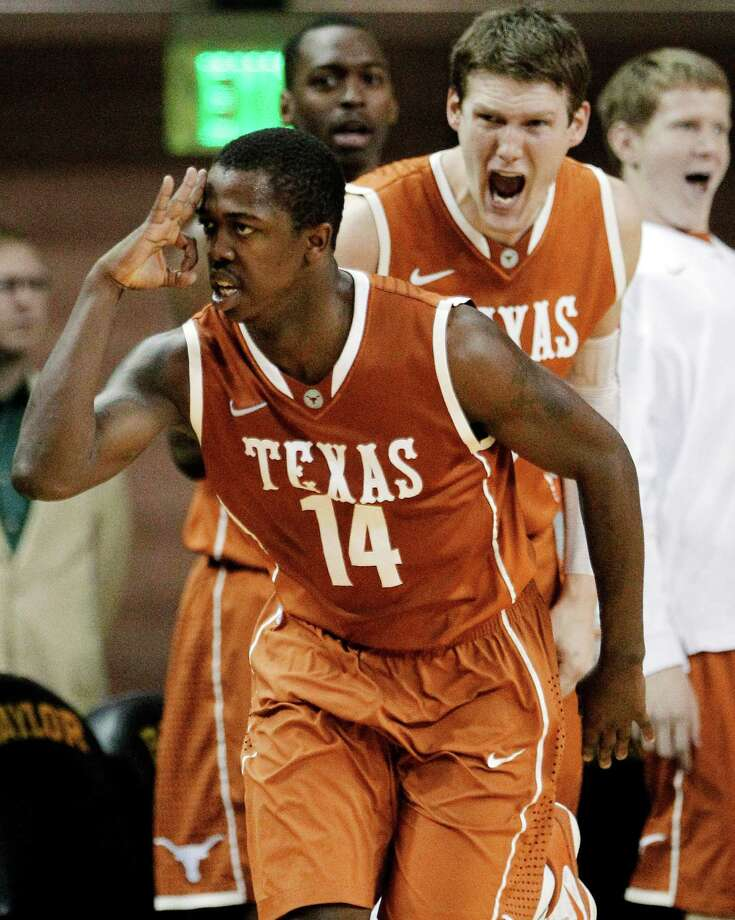 Texas' J'Covan Brown (14) celebrates a 3-pointer as Clint Chapman cheers from the bench in the second half of an NCAA college basketball game against Baylor, Saturday, Jan. 28, 2012, in Waco, Texas. Baylor won 76-71. (AP Photo/Tony Gutierrez) Photo: The Associated Press, STF / AP2012