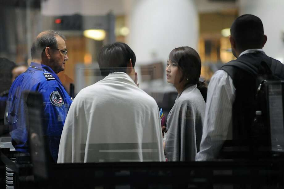 Victims of the Asiana plane crash are screened by TSA workers as they enter a security checkpoint in the International Terminal at SFO in San Francisco, CA on Saturday, July 6th, 2013. Photo: Michael Short, Special To The Chronicle