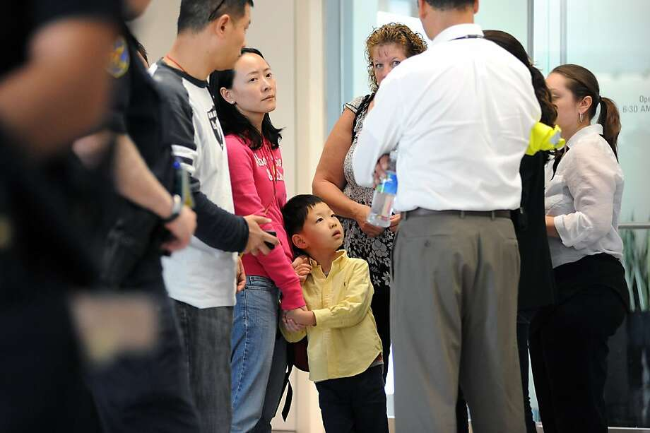Potential family of victims of the Asiana plane crash are breifed outside the Reflection Room in the North Wing of the International Terminal at SFO in San Francisco, CA on July 6th, 2013. Photo: Michael Short, Special To The Chronicle