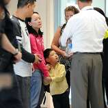 Potential family of victims of the Asiana plane crash are breifed outside the Reflection Room in the North Wing of the International Terminal at SFO in San Francisco, CA on July 6th, 2013.
