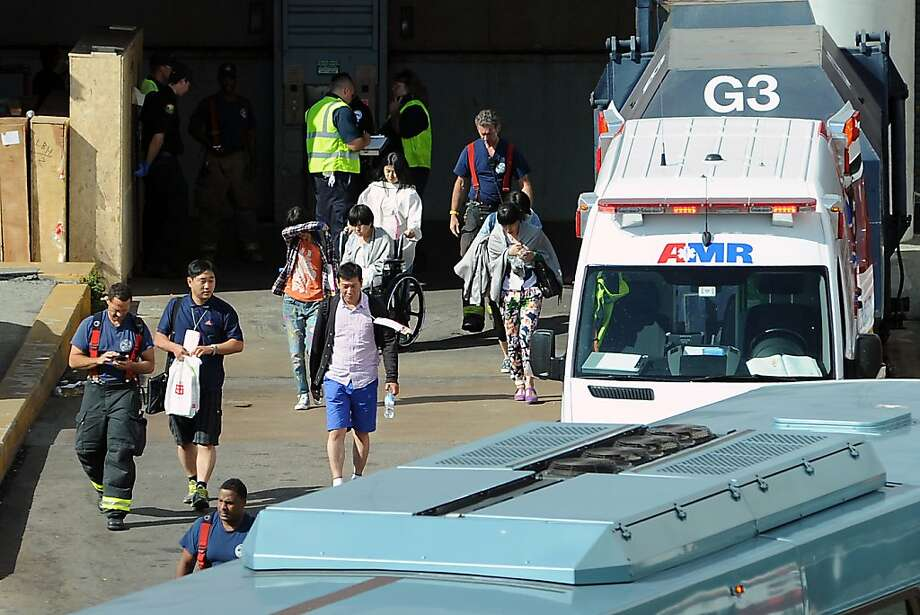 Victims of the Asiana plane crash are loaded onto waiting buses at the North Wing of the International Terminal at SFO in San Francisco, CA on July 6th, 2013. Photo: Michael Short, Special To The Chronicle