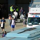 Victims of the Asiana plane crash are loaded onto waiting buses at the North Wing of the International Terminal at SFO in San Francisco, CA on July 6th, 2013.