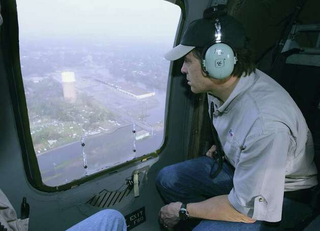 Texas Gov. Rick Perry views the damage caused by Hurricane Rita during a flight over a flooded area outside Port Arthur, Sept. 25, 2005. Photo: HARRY CABLUCK, AP / AP