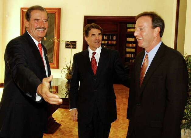 Mexico's President Vicente Fox (from left) welcomes Texas Gov. Rick Perry and U.S. ambassador to Mexico Tony Garza during a private meeting at the official residence Los Pinos, June 23, 2004, in Mexico City. Photo: JOSE LUIS MAGANA, AP / AP