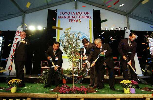 Dignitaries from Toyota and Texas officially break ground on their site on the South Side of San Antonio, Oct. 17, 2003. Officials planted trees to symbolize Toyota putting down roots in Texas. Participating are (from left) Bexar County judge Nelson Wolff, Toyota Motor Manufacturing of Texas president T.J. Tajima, Gov. Rick Perry, Toyota honorary chairman Shoichiro Toyoda and San Antonio mayor Ed Garza.  Photo: KIN MAN HUI, SAN ANTONIO EXPRESS-NEWS / SAN ANTONIO EXPRESS-NEWS