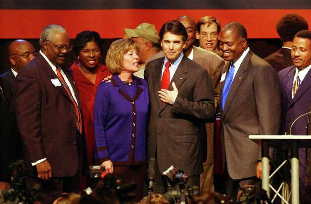 STATE SAELN PERRY AUSTIN 11/5/02 Texas Governor Rick Perry, center right, and Susan Weddington, Republican Party Texas Chairperson, celebrate on stage after he declared victory against Democrat Tony Sanchez during Election Night at the Republican Party of Texas Headquarters at the Austin Convention Center on Tuesday, Nov. 5, 2002. ( JERRY LARA STAFF ) Photo: JERRY LARA, SAN ANTONIO EXPRESS-NEWS / SAN ANTONIO EXPRESS-NEWS