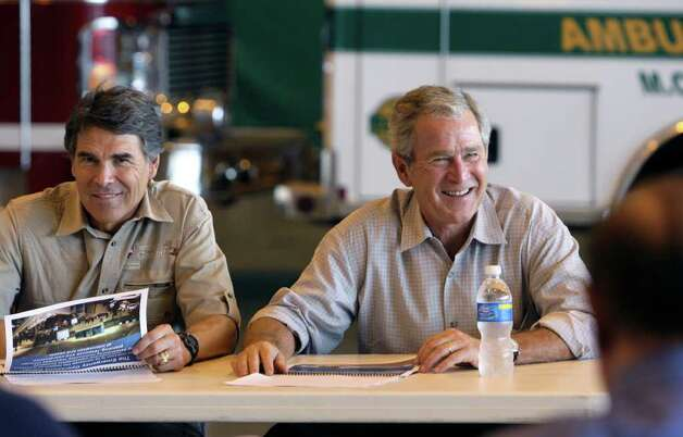 President George W. Bush and Texas Gov. Rick Perry listen during a briefing on local efforts in aiding Hurricane Gustav evacuees in San Antonio, Sept. 1, 2008.  Photo: JERRY LARA, SAN ANTONIO EXPRESS-NEWS / glara@express-news.net