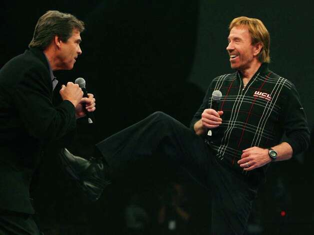 Governor Rick Perry (left) and Chuck Norris joke prior to the start of the World Combat League fights Friday Jan. 18, 2008, at the Freeman Coliseum in San Antonio. Photo: EDWARD A. ORNELAS, SAN ANTONIO EXPRESS-NEWS / SAN ANTONIO EXPRESS-NEWS