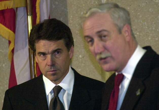 Gov. Rick Perry listens as NASA Administrator Sean O'Keefe speaks in Lufkin about the Shuttle Columbia disaster, Feb. 8, 2003. Columbia broke apart over East Texas upon re-entry. Photo: BILLY CALZADA, SAN ANTONIO EXPRESS-NEWS / SAN ANTONIO EXPRESS-NEWS