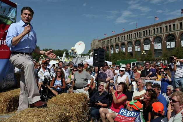 Governor Rick Perry campaigns for president at the Des Moines Register Soapbox at the Iowa State Fair in Des Moines, Iowa, Aug. 14, 2011. Photo: LISA KRANTZ, LISA KRANTZ/lkrantz@express-news.net / SAN ANTONIO EXPRESS-NEWS