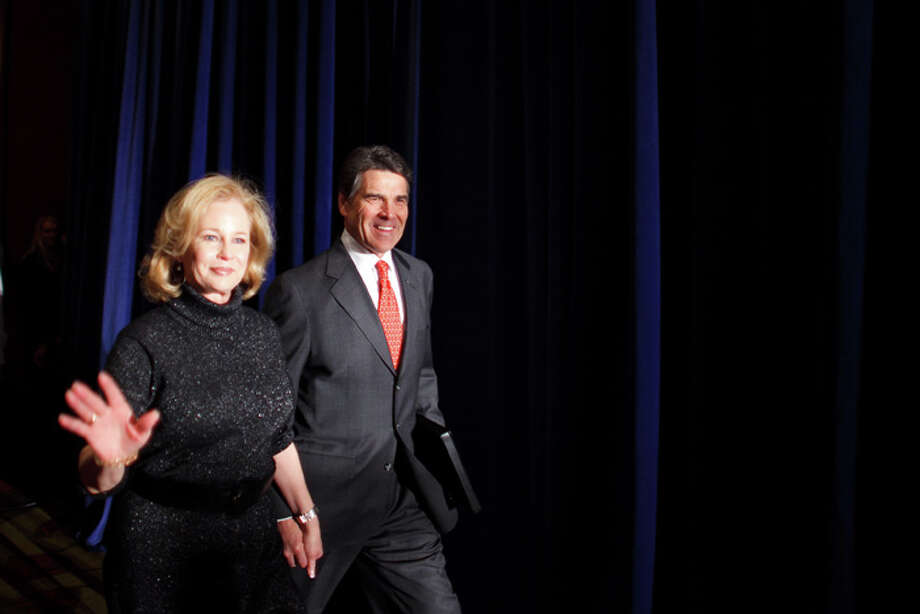 Perry, with wife Anita on the night of the Iowa caucus Jan. 3, placed fifth in the state and had decided to reassess his candidacy. Photo: Jonathan Gibby, Getty Images / 2012 Getty Images