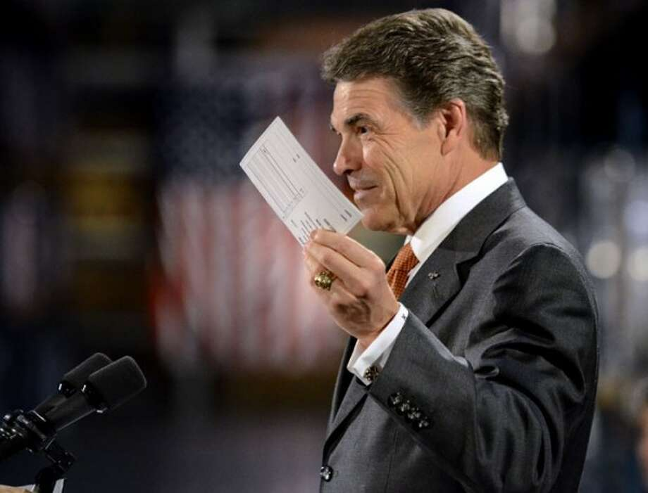 "Perry announced his flax-tax economic plan, ""cut, balance, grow,"" in October. He said Americans would be able to fill out their taxes on a postcard."