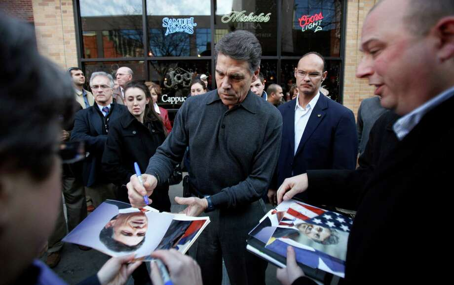 Perry raised more than $17 million during the first six weeks of his campaign and consistently topped totals by Gingrich, Bachmann, Santorum and Huntsman. Photo: Charlie Neibergall, Associated Press / AP