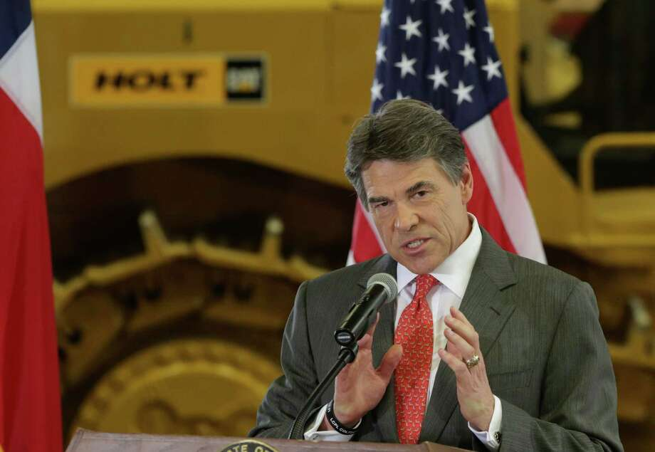 Texas Gov. Rick Perry announces he is not seeking re-election on Monday, July, 8, 2013, during an announcement at Holt Cat Co. in San Antonio. Photo: Bob Owen, San Antonio Express-News / ©2013 San Antonio Express-News