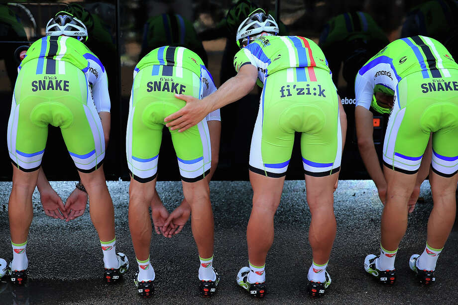 Peter Sagan of Slovakia — who got himself into hot water earlier this year for pinching the butt of a so-called podium girl — plays a joke on a Cannondale teammate as they pose for a team photo with the media as they prepare for a training ride on the eve of the 2013 Tour de France on June 28, 2013 in Porto Vecchio, France. The 100th edition of Le Tour de France begins in Porto Vecchio on the island of Corsica and ends July 21 in Paris. Photo: Doug Pensinger, Getty Images / 2013 Getty Images