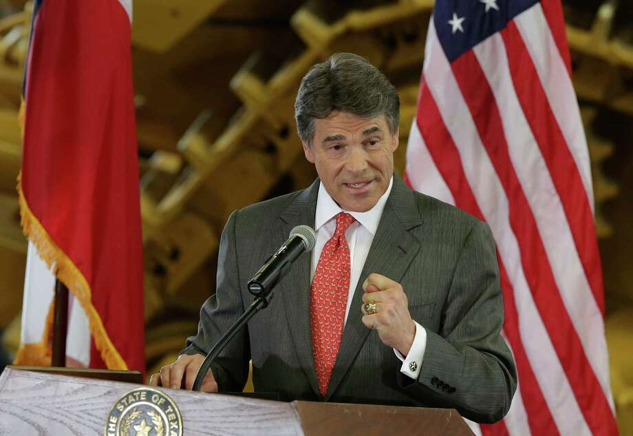 A special prosecutor will investigate charges of coercion, bribery and official oppression against Gov. Rick Perry for vetoing funding for the Travis County District Attorney's Public Integrity  Unit. Photo: Bob Owen, San Antonio Express-News / ©2013 San Antonio Express-News