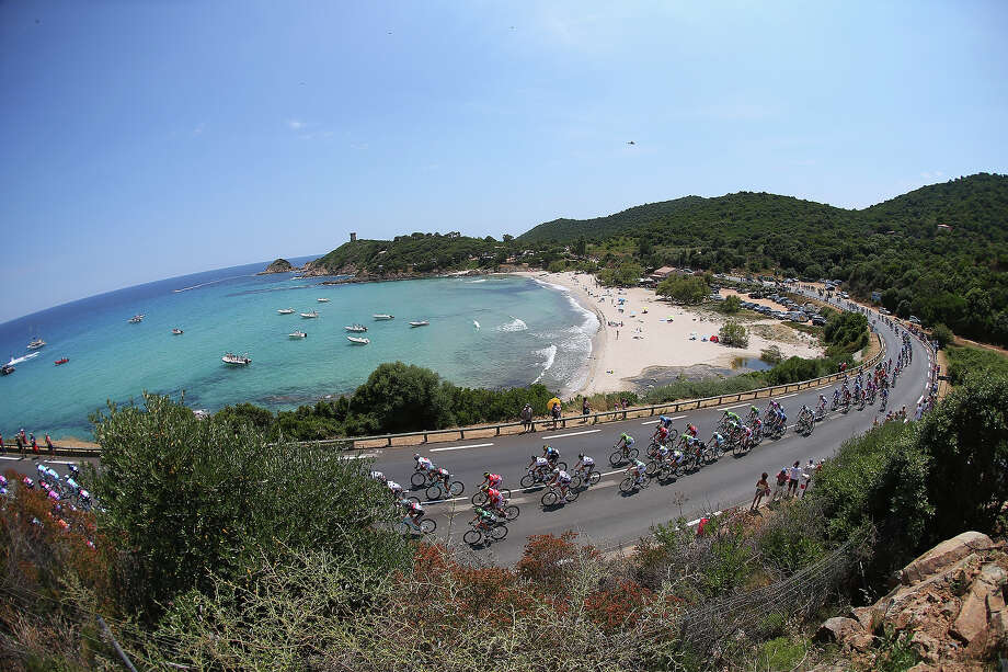 The peloton rides by the coast during stage one of the 2013 Tour de France, a 213KM road stage from Porto-Vecchio to Bastia, on June 29, 2013 near Sari-Solenzara, France. Photo: Bryn Lennon, Getty Images / 2013 Getty Images