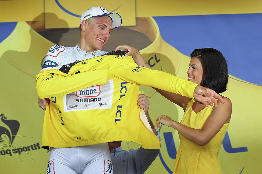 Marcel Kittel of Germany and Argos-Shimano puts on the yellow jersey after winning stage one of the 2013 Tour de France, a 213KM road stage from Porto-Vecchio to Bastia, on June 29, 2013 in Bastia, France. Photo: Doug Pensinger, Getty Images / 2013 Getty Images