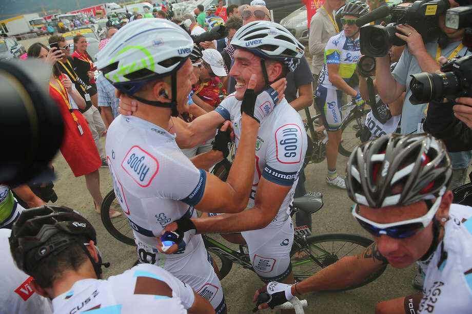 Marcel Kittel of Germany and Argos-Shimano is congratulated by team mate John Degenkolb of Germany after winning stage one of the 2013 Tour de France, a 213KM road stage from Porto-Vecchio to Bastia, on June 29, 2013 in Bastia, France. Photo: Bryn Lennon, Getty Images / 2013 Getty Images