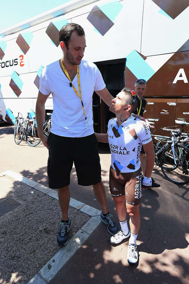 Basketball player Tomas Van Den Spiegel of Belgium interviews Samuel Dumoulin (R) of France and Team AG2R La Mondiale is seen prior to the start of stage two of the 2013 Tour de France, a 156KM road stage from Bastia to Ajaccio, on June 30, 2013 in Bastia, France. Photo: Doug Pensinger, Getty Images / 2013 Getty Images