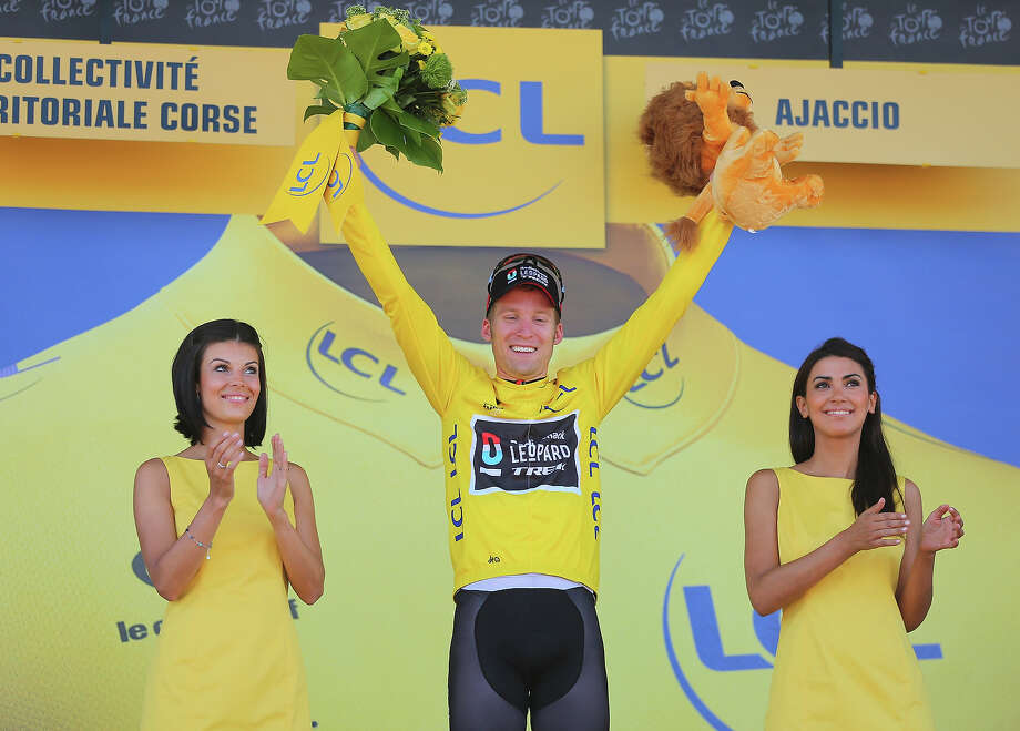 Jan Bakelants of Belgium and Radioshack Leopard celebrates on the podium as he wears the yellow jersey after winning stage two of the 2013 Tour de France, a 156KM road stage from Bastia to Ajaccio, on June 30, 2013 in Ajaccio, France. Photo: Bryn Lennon, Getty Images / 2013 Getty Images