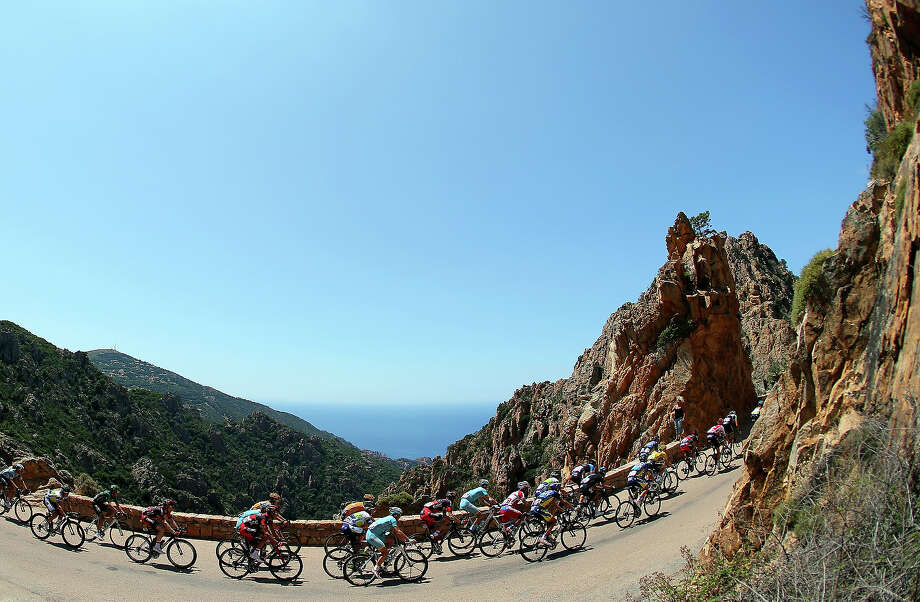 The peloton ride along the Corsican coast during stage three of the 2013 Tour de France, a 145.5KM road stage from Ajaccio to Calvi, on July 1, 2013 in Calvi, France. Photo: Bryn Lennon, Getty Images / 2013 Getty Images