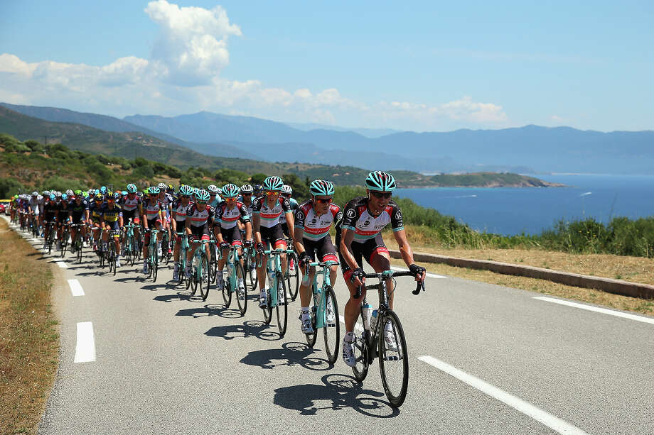 Jens Voigt of Germany and Radioshack Leopard leads the peloton along the Corsican coast during stage three of the 2013 Tour de France, a 145.5KM road stage from Ajaccio to Calvi, on July 1, 2013 in Calvi, France. Photo: Bryn Lennon, Getty Images / 2013 Getty Images