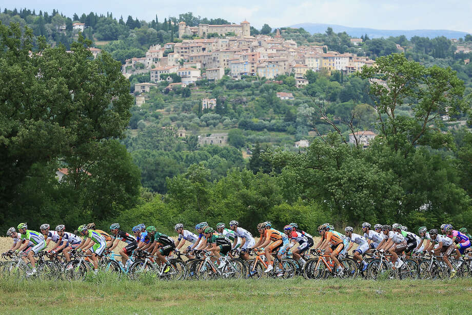 The peloton passes through countryside near the 50km part of the stage during stage five of the 2013 Tour de France, a 228.5KM road stage from Cagnes-sur-mer to Marseille, on July 3, 2013 in Marseille, France. Photo: Doug Pensinger, Getty Images / 2013 Getty Images