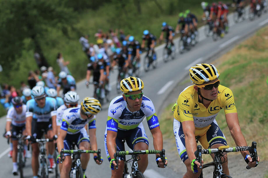 Simon Gerrans of Australia riding for Orica-GreenEdge rides in the peloton as he successfully defends the overall race leader's yellow jersey during stage five of the 2013 Tour de France, a 228.5KM road stage from Cagnes-sur-mer to Marseille, on July 3, 2013 in Lorgues, France. Photo: Doug Pensinger, Getty Images / 2013 Getty Images
