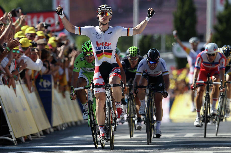Andre Greipel of Germany riding for Lotto-Belisol celebrates as he crosses the finish line to win stage six of the 2013 Tour de France, a 176.5KM road stage from Aix-en-Provence to Montpellier, on July 4, 2013 in Montpellier, France. Photo: Doug Pensinger, Getty Images / 2013 Getty Images
