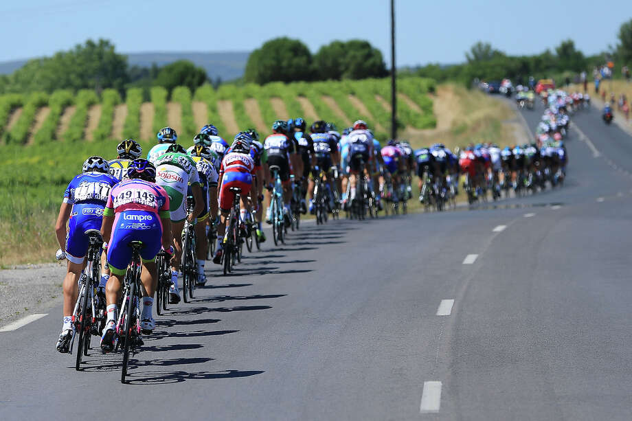 The peloton passes through countryside during stage seven of the 2013 Tour de France, a 205.5KM road stage from Montpellier to Albi, on July 5, 2013 in Montpellier, France. Photo: Doug Pensinger, Getty Images / 2013 Getty Images