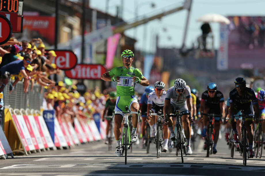 Peter Sagan of Slovakia and Team Cannondale celebrates as he crosses the finish line to win stage seven of the 2013 Tour de France, a 205.5KM road stage from Montpellier to Albi, on July 5, 2013 in Albi, France. Photo: Bryn Lennon, Getty Images / 2013 Getty Images